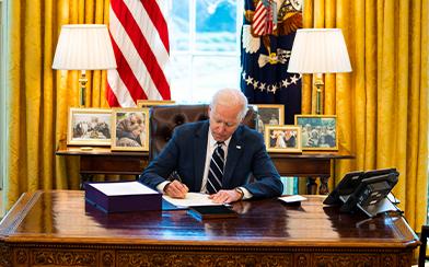 Joe Biden signs American Rescue Plan into law.