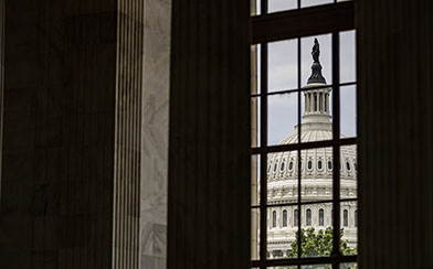 The U.S. Capitol Dome is seen through a window in the in the Rotunda of the Russell Senate Office Building.