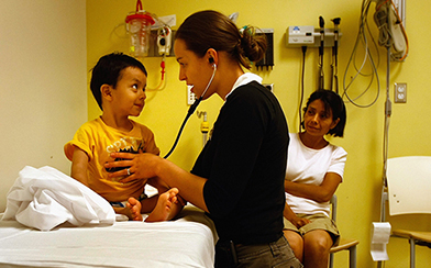 Pediatric doctor treating a Medicaid patient