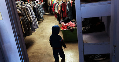 A child is viewed at a thrift store operated by Gonzales Christian Assistance Ministry.