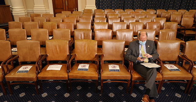Members of Congress are spaced apart for social distancing during a House Rules Committee hearing.