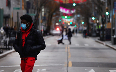 A man walks down a street in Brooklyn on December 01, 2020 in New York City. New York City, and much of the nation, is bracing for a surge of COVID-19 cases